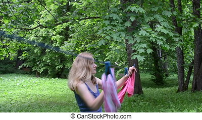 woman hang laundry - Woman hanging laundry towel on...