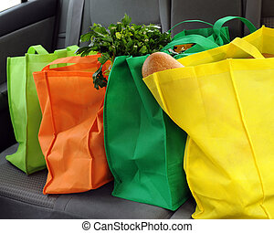 Eco-Friendly Shopping - Four colorful eco-friendly shopping...
