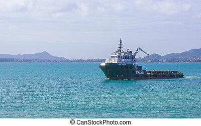 Tugboat sailing in the sea