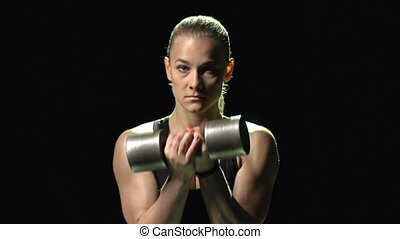 Power lifting - Girl lifting a dumb-bell
