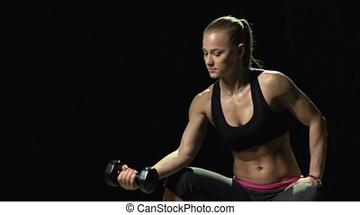 Working out with Dumbbells - Woman sitting on the bench...