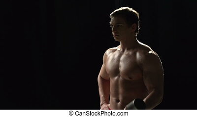 Sexy Bodybuilder - Standing man with naked torso pushing...