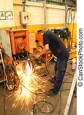 welding sparking - The worker are welding sparks and...