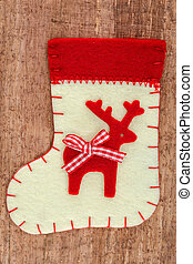 Christmas decorations and sock on wood background. Beautiful...