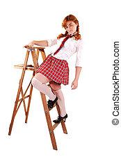Schoolgirl on stepladder.