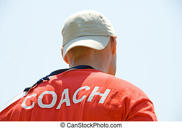 Coach - A coach getting ready to instruct his team.