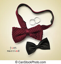 just married - a pair of bow ties, one of them forming a...