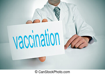 vaccination - a man wearing a white coat showing sitting in...