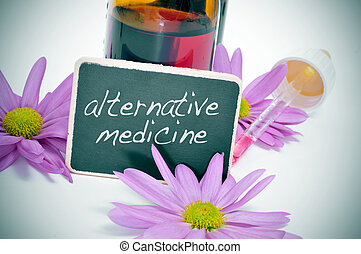 alternative medicine - a dropper bottle and some flowers...