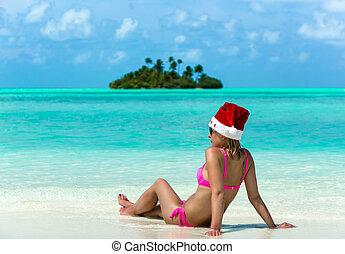 santa claus woman on beach