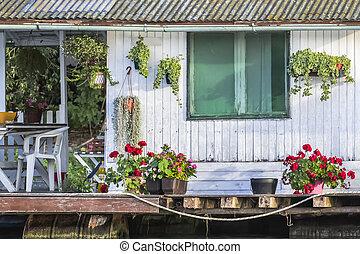 Old Wooden White Raft Hut