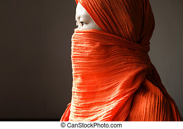 islamic woman - Close-up of a islamic woman covered with a...