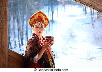 Russian girl in a kokoshnik - Russian girl drinking tea in...