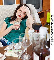woman having headache after celebrating of holiday