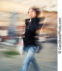 young woman talking on a cell phone - Abstract image of a...