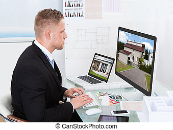 Businessman checking a property portfolio online -...