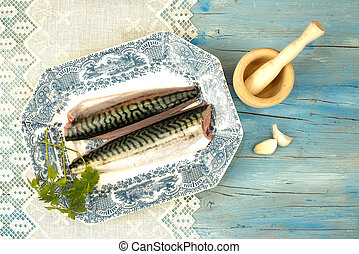 Fresh fish and ingredients decorated vintage