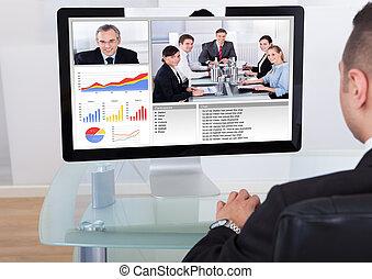 hombre de negocios, vídeo, Conferencia, con, equipo