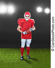 Portrait Of Confident American Football Player On Field -...