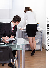 Pervert Businessman Looking At Businesswoman - Young pervert...