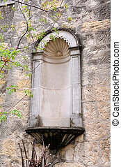 Niche in the Wall - Stone Niche on the exterior of an old...