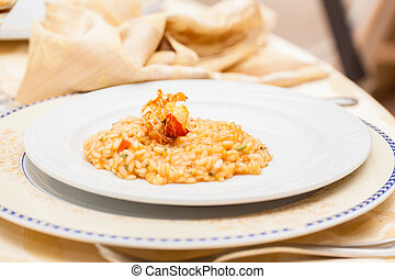 Risotto - a delicious risotto  served in a white plate