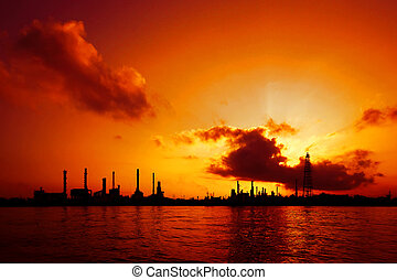 Silhouette of oil refinery at sunrise in Bangkok, Thailand