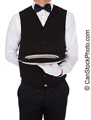 Waiter Holding Empty Tray - Midsection of waiter holding...