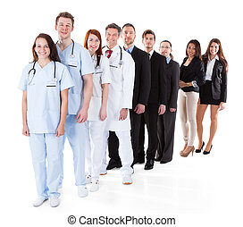 Doctors and managers standing in row Isolated on white