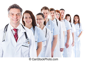 Long line of smiling doctors and nurses - Long receding line...