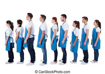 Large group of cleaners standing in a queue - Large diverse...