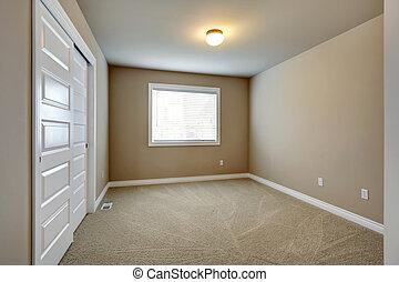 Empty beige room with window, closet and capret floor