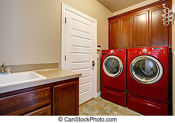 Laundry room with modern red appliances - Laundry room with...