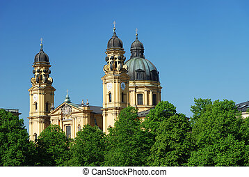 Theatiner church in Munich with flowering trees - Theatiner...