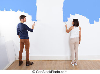 Couple Painting New House