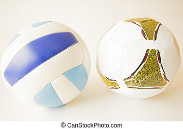isolated object - Football and volleyball on a white...