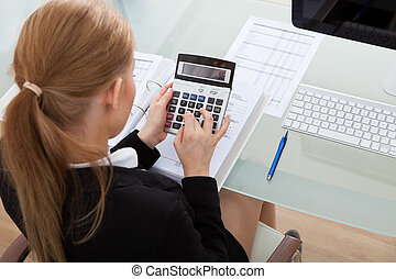 Young Businesswoman Working At Desk - Portrait Of Happy...