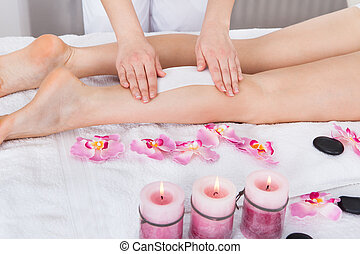 Beautician Waxing Womans Leg Applying Wax Strip