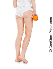 Low Section Of Woman Holding Orange Isolated On White...