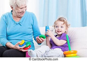 Grandmother playing with grandson - Grandmother playing...