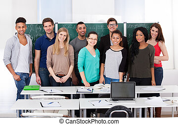 Confident College Students Standing Together In Classroom -...