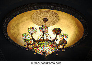 A Stained-Glass Chandellier - A lit stained glass chandelier...