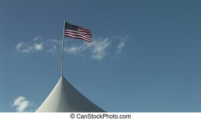 American Flag Waving in the Wind - Old Glory raised over a...