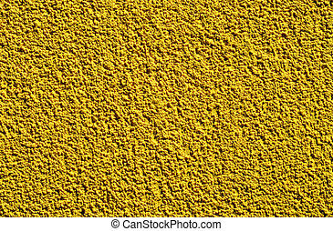 Detail of a rugged yellow wall suitable as background