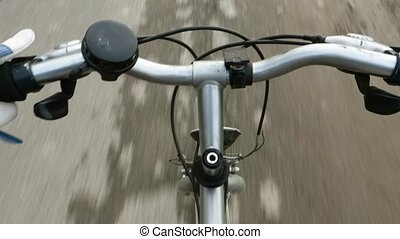 ride pov - cyclist riding a bicycle, handlebar detail