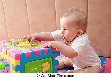 Baby playing - Portrait of cute newborn playing with toys