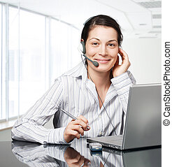 Customer Service - Young and smiling operator works on a...