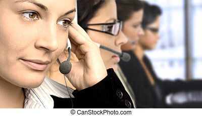 Customer Service - Young female operators in headset.