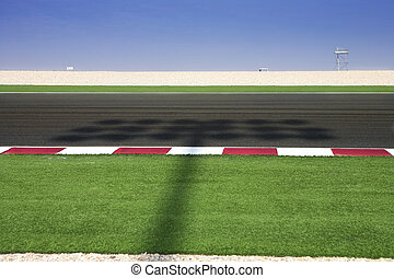 Lusail Race Track - Section of astro turf and asphalt next...