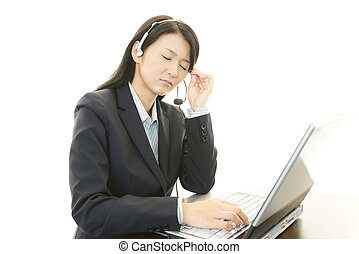 Tired call center operator - The operator who was tired from...